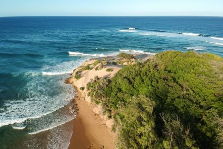 drone shot of a beach on an island