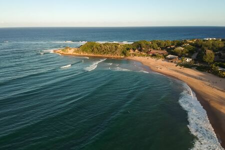drone shot of a beach with native residents