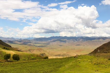 panormaic view with white clouds and green countryside Stockfoto