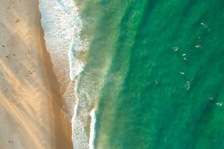 top view drone shot of green water with surfer