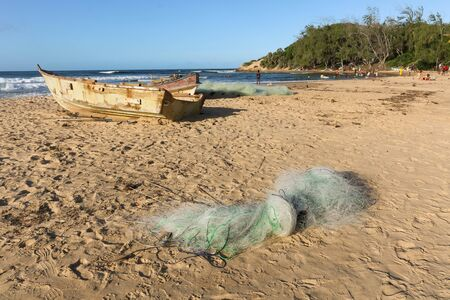 old used fishermen boats with fisher net on beach in Tofo, Mozambique