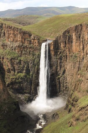 close-up of stunning waterfall running down a steap canyon Banco de Imagens
