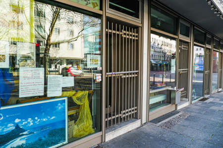 Coronavirus lockdown. Frankfurt, Germany. April 5, 2020. Closed stores barred with.metal doors during covid-19 quarantine.