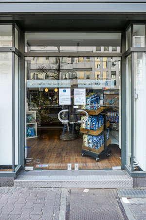 Coronavirus lockdown. Frankfurt, Germany. April 5, 2020. Closed glass doors of store during covid-19 quarantine.