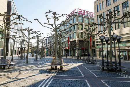 Coronavirus lockdown. Frankfurt, Germany. April 5, 2020. Zeil promenade and shopping zone with empty benches during covid-19 lockdown.