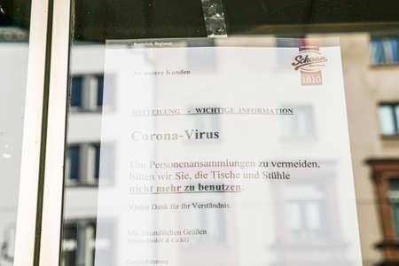 Coronavirus lockdown. Frankfurt, Germany. April 5, 2020. Coronavirus warning sign printout in German on glass.