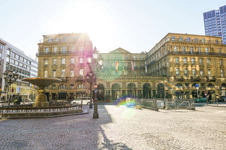 Coronavirus lockdown. Frankfurt, Germany. April 5, 2020. Kaiserplatz town square empty on sunny day with luxury hotel exterior during quarantine.