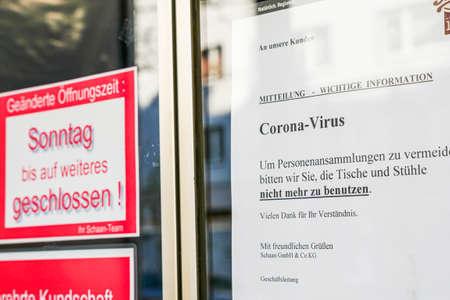 Coronavirus lockdown. Frankfurt, Germany. April 5, 2020. Coronavirus warning sign printouts in German on glass doors.