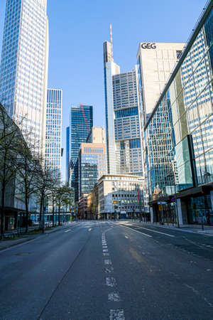 Coronavirus lockdown. Frankfurt, Germany. April 5, 2020. Bankenviertel financial banking district skyscrapers and deserted street during covid19 pandemic. Editorial