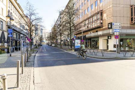 Coronavirus lockdown. Frankfurt, Germany. April 5, 2020. Street in downtown Frankfurt with no traffic and one bicycle rider during quarantine.