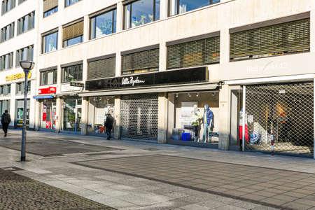 Coronavirus lockdown. Frankfurt, Germany. April 5, 2020. Barred clothing retailer store on pedestrian zone during covid-19 pandemic. Redactioneel