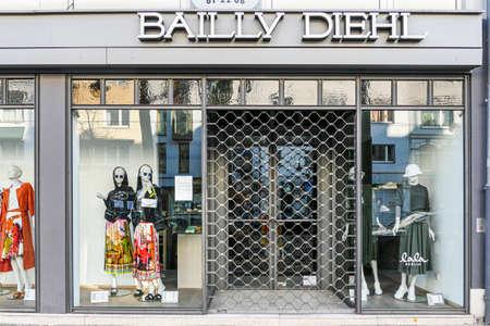 Coronavirus lockdown. Frankfurt, Germany. April 5, 2020. Barred doors of fashion clothing store during the covid-19 pandemic.