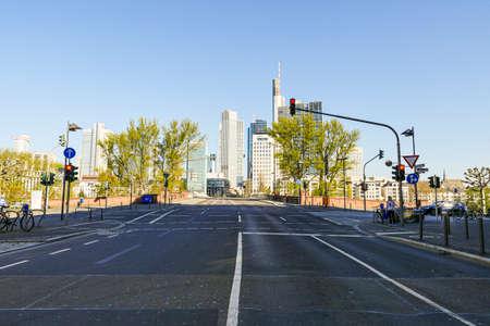 Coronavirus lockdown. Frankfurt, Germany. April 5, 2020. Empty road with Frankfurt's Financial District Bankenviertel in distance. Editorial