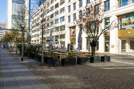 Coronavirus lockdown. Frankfurt, Germany. April 5, 2020. Empty outdoor restaurant tables in pedestrian zone during covid-19 quarantine.