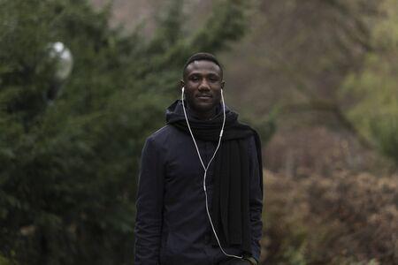Medium Shot Portrait of Young Black Man in Park