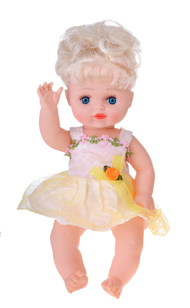 Girl doll sitting in colorful dress on white background 스톡 콘텐츠