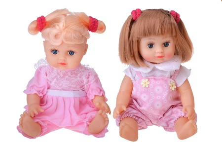 Girls dolls sitting in colorful dress on white background