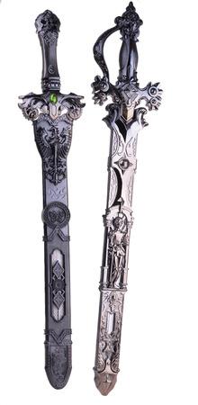 war decoration: Ancient ornate swords Stock Photo