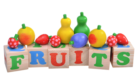 wooden toy: wooden toy cubes with letters. Fruit concept isolated on white background
