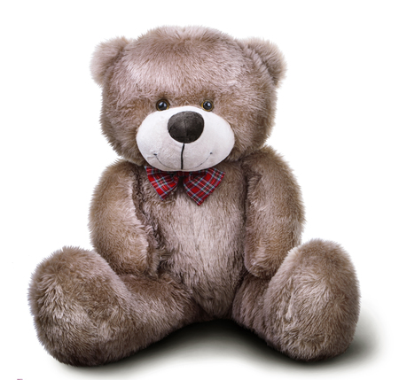 Toy soft teddy bear with bow isolated over white background with shadow 스톡 콘텐츠