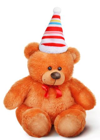 osos de peluche: Juguete suave del oso de peluche con el arco en el sombrero de Santa Claus aislados sobre fondo blanco con la sombra