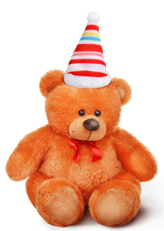birthday teddy bear: Toy soft teddy bear with bow in santa claus hat isolated over white background with shadow