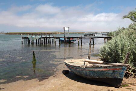 river bank: Boat on river bank