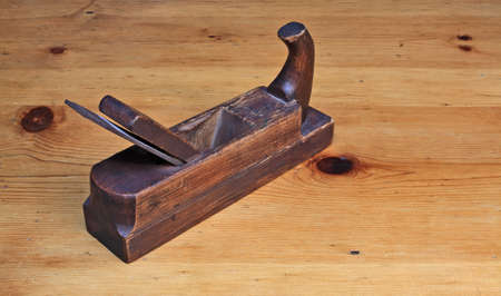 wood planer: Wood planer on wooden table Stock Photo