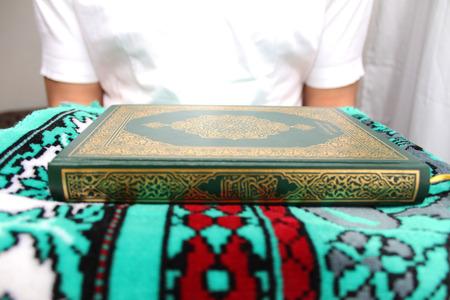 koran: Young man reading the Holy Koran Stock Photo