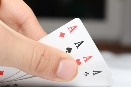 ace: Four Poker card of ace in hand Stock Photo