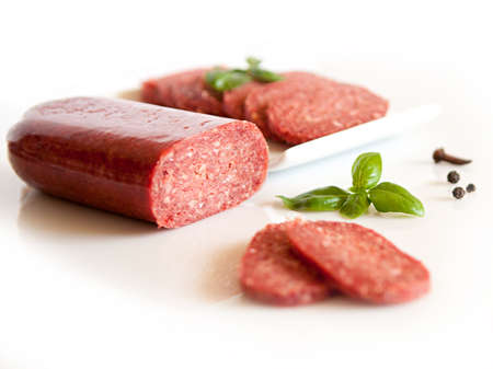 salami slices isolated on white photo