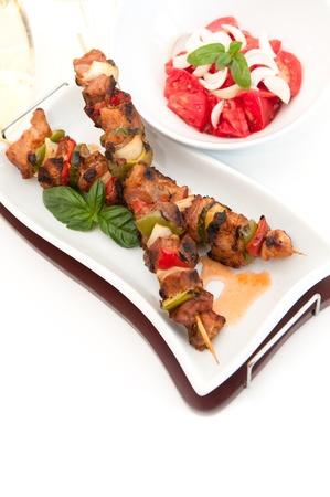 meat skewers: Grilled skewer and salad
