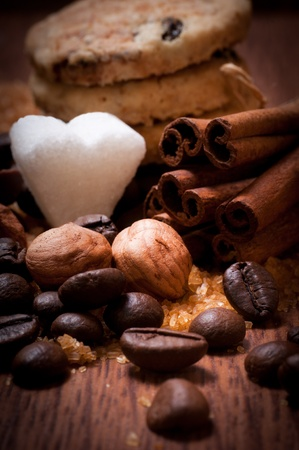 Various kinds of sugar, nuts and coffee beans photo