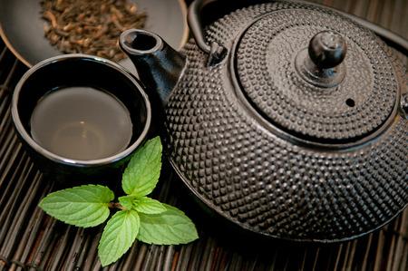 chinese herbs: Green tea - Black iron Asian teapot