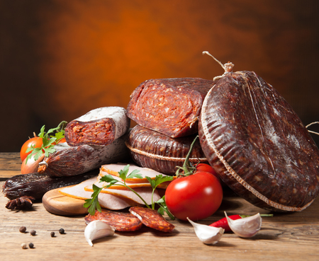 meat counter: Variety of sausage products with vegetables
