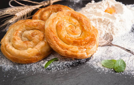 Bakery background – home made cheese pie on black board 스톡 콘텐츠