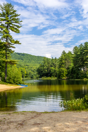Scenic mountain  pond where you can kayak and swim in New Hampshire