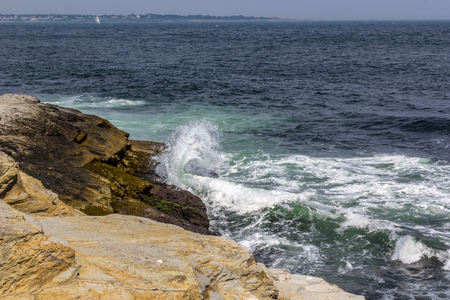 Waves splashing against rocky shore