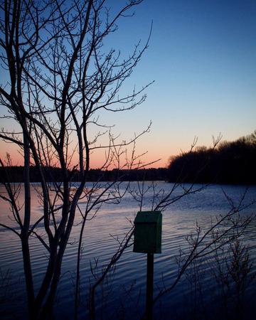 Mailbox near frosty lake during sunset in seekonk Massachusetts