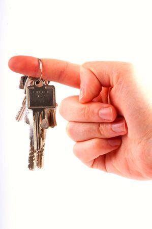 A hand with keys for a  housecar photo