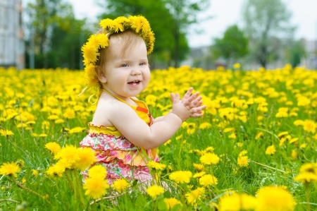 Happy little girl  on the meadow