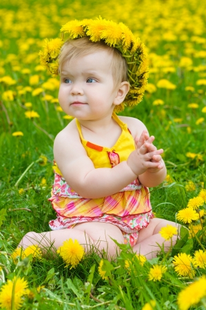 Happy little girl  on the meadow photo