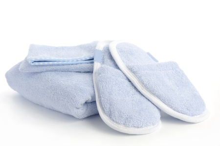 blue slippers, towel and bath   shower mitt isolated on white