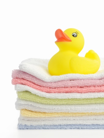 yellow duck: Bath accessories. Bath towels and Yellow rubber duckies Stock Photo