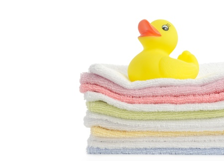 bathroom duck: Bath accessories. Bath towels and Yellow rubber duckies Stock Photo