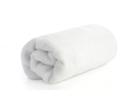 rolled up white beach towel on  white background