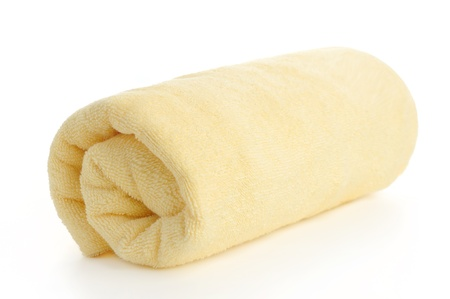 rolled up yellow beach towel on  white background Stock Photo