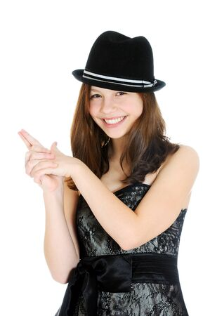 Attractive brunette young teenage girl with hand in shape of a gun isolated