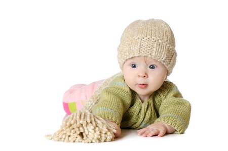 Portrait of five months old baby girl wearing knitted winter hat Stock Photo