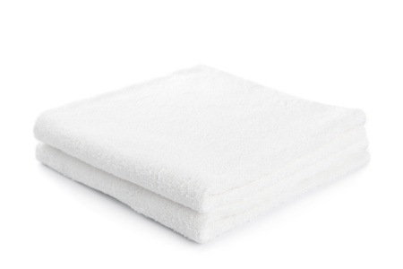 bathtime: stack of white towels isolated on white Stock Photo